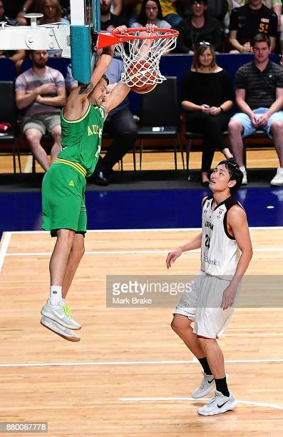 Nathan Sobey of Australia slam dunks during the FIBA 2019 Asia Cup Qualifier match between the Australian Boomers and Japan at Adelaide Arena on...