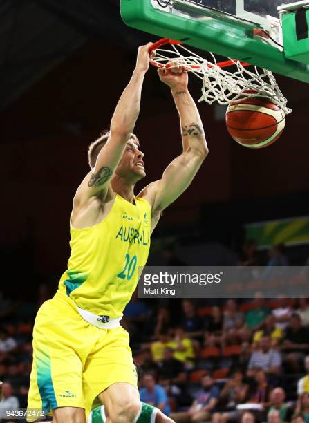 Nathan Sobey of Australia slam dunks during the Preliminary Basketball round match between Australia and Nigeria on day five of the Gold Coast 2018...