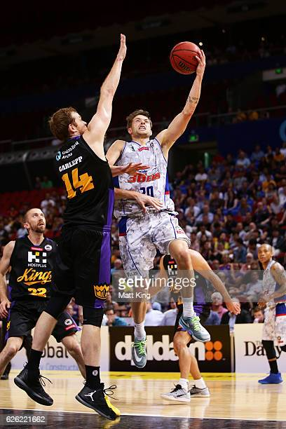 Nathan Sobey of the 36ers drives to the basket under pressure from Tom Garlepp of the Kings during the round eight NBL match between the Sydney Kings...