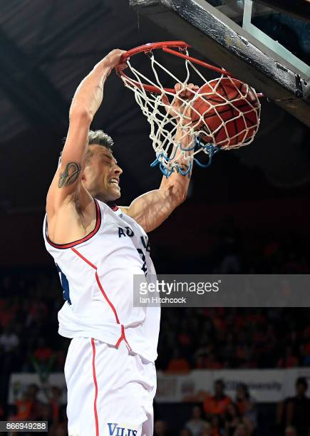 Nathan Sobey of the 36ers slam dunks the ball during the round four NBL match between the Cairns Taipans and the Adelaide 36ers at Cairns Convention...