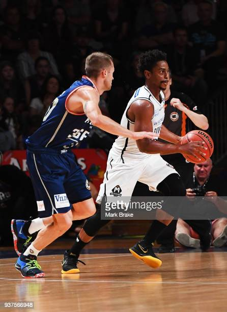 Nathan Sobey of the Adelaide 36ers defends Casper Ware of Melbourne United during game four of the NBL Grand Final series between the Adelaide 36ers...