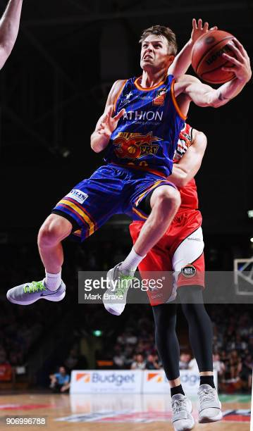 Nathan Sobey of the Adelaide 36ers flys for the basket in front of Tim Coenraad of the Illawarra Hawks during the round 15 NBL match between the...