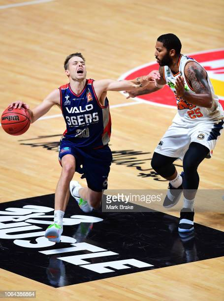 Nathan Sobey of the Adelaide 36ers gets fouled by DJ Newbill of the Taipans during the round seven NBL match between the Adelaide 36ers and the...