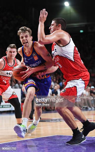 Nathan Sobey of the Adelaide 36ers head to basket past Cody Ellis of the Illawarra Hawks during the round 15 NBL match between the Adelaide 36ers and...