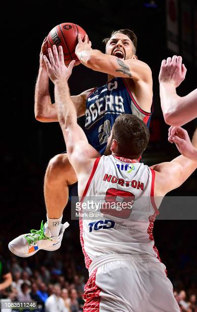 Nathan Sobey of the Adelaide 36ers heads for the basket over Mitch Norton of the Pert Wildcats during the round 14 NBL match between the Adelaide...