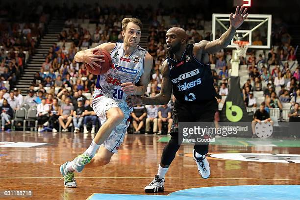 Nathan Sobey of the Adelaide 36ers heads for the basket with Kevin Dillard of the NZ Breakers in defence during the round 14 NBL match between the...