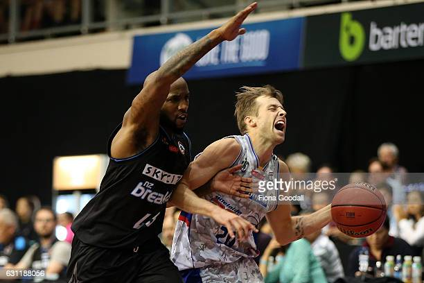 Nathan Sobey of the Adelaide 36ers is defended by Kevin Dillard of the NZ Breakers during the round 14 NBL match between the New Zealand Breakers and...