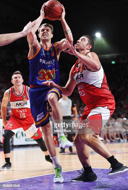 Nathan Sobey of the Adelaide 36ers makes a basket past Cody Ellis of the Illawarra Hawks during the round 15 NBL match between the Adelaide 36ers and...