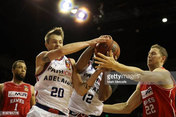 Nathan Sobey of the Adelaide 36ers Shannon Shorter of the Adelaide 36ers and Tim Coenradd of the Hawks compete for a rebound during the round 18 NBL...