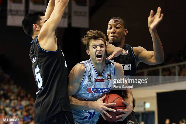 Nathan Sobey of the Adelaide 36ers with Akil Mitchell and Shea Ili of the NZ Breakers during the round 14 NBL match between the New Zealand Breakers...