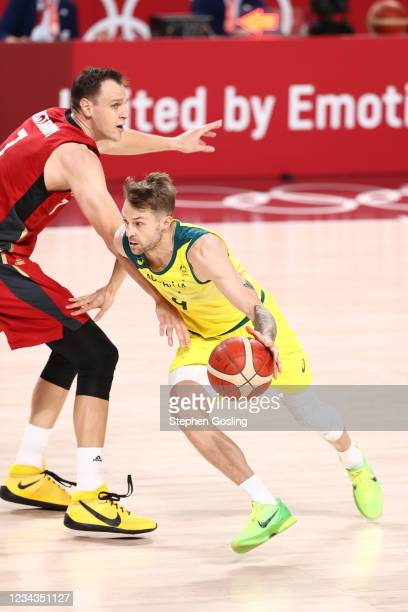 Nathan Sobey of the Australia Men's National Team dribbles the ball during the game against the Germany Men's National Team during the 2020 Tokyo...