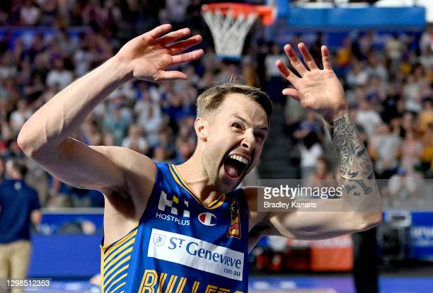 Nathan Sobey of the Bullets celebrates victory as he calls out to his family after the round three NBL match between the Brisbane Bullets and the...