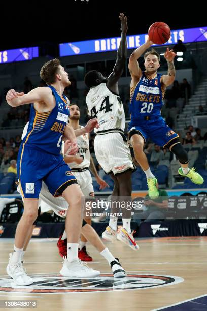 Nathan Sobey of the Bullets dishes off during the NBL Cup match between the Brisbane Bullets and the Adelaide 36ers at John Cain Arena on March 11 in...