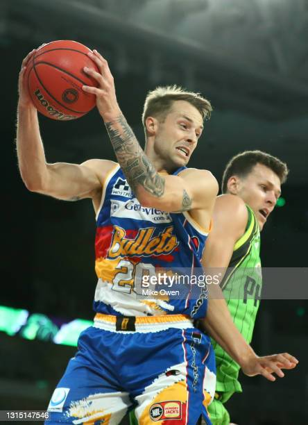 Nathan Sobey of the Bullets grabs the rebound during the round 16 NBL match between the South East Melbourne Phoenix and the Brisbane Bullets and...