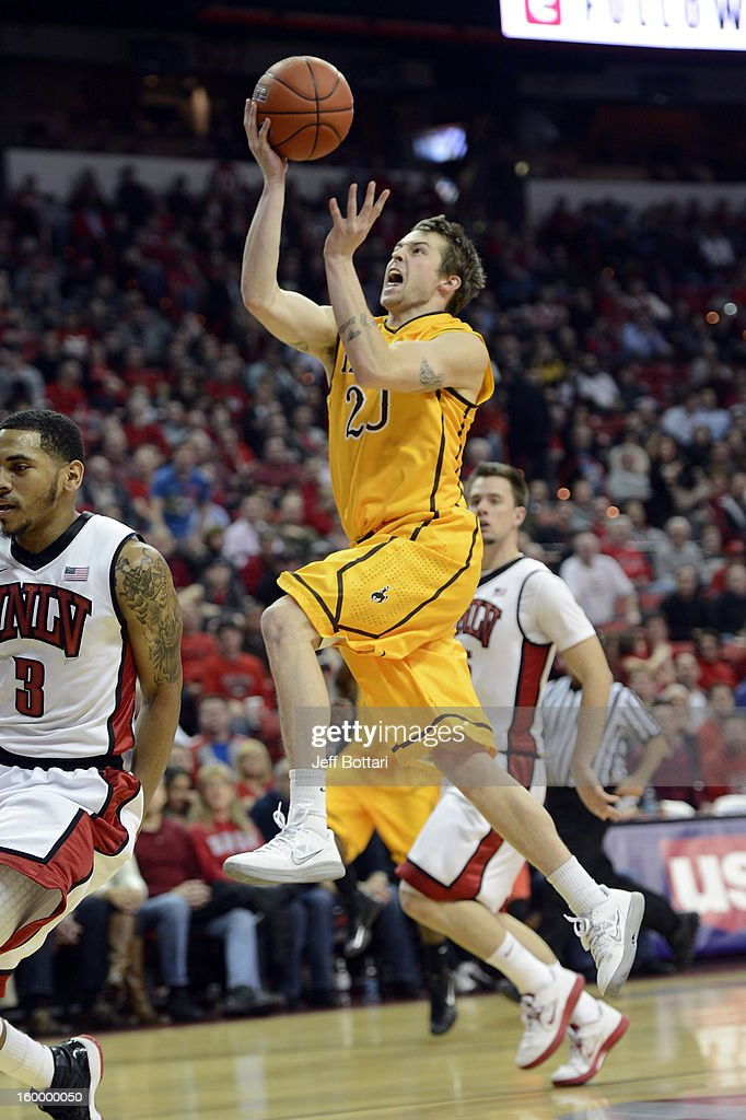 Nathan Sobey #20 of the Wyoming Cowboys drives to the basket against Anthony Marshall #3 of the UNLV Rebels at the Thomas & Mack Center January 24, 2013 in Las Vegas, Nevada.