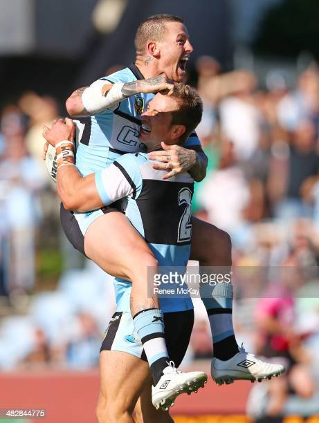 Nathan Stapleton of the Sharks celebrates his 4th try with team mate Todd Carney during the round five NRL match between the CronullaSutherland...