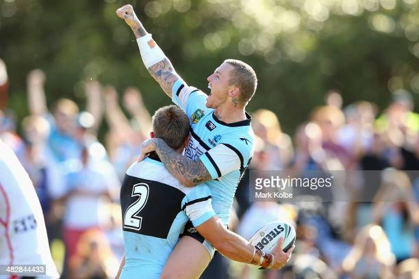 Nathan Stapleton of the Sharks celebrates with Todd Carney of the Sharks after Stapleton scored his fourth try during the round five NRL match...