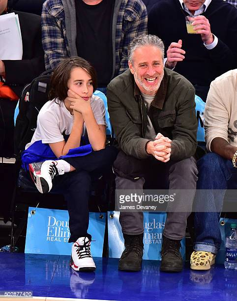 Nathan Stewart and Jon Stewart attend the Detroit Pistons vs New York Knicks game at Madison Square Garden on December 29 2015 in New York City