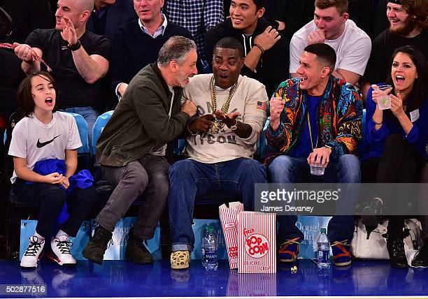 Nathan Stewart Jon Stewart Tracy Morgan guest and Cecily Strong attend the Detroit Pistons vs New York Knicks game at Madison Square Garden on...