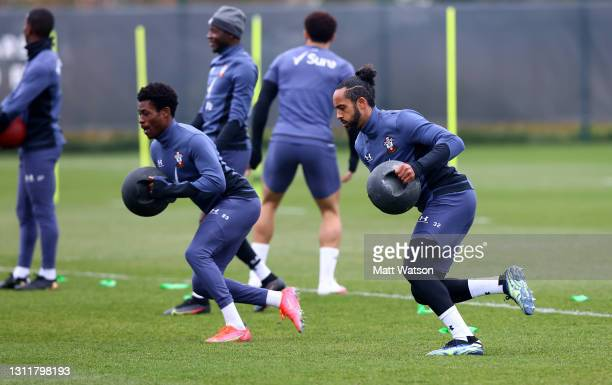 Nathan Tella and Theo Walcott during a Southampton FC training session at the Staplewood Campus on April 10, 2021 in Southampton, England.