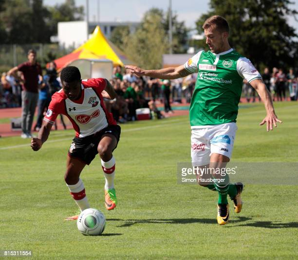 Nathan Tella from FC Southampton and Alain Wiss from St Gallen in action during the preseason friendly match between FC Southampton and St Gallen at...