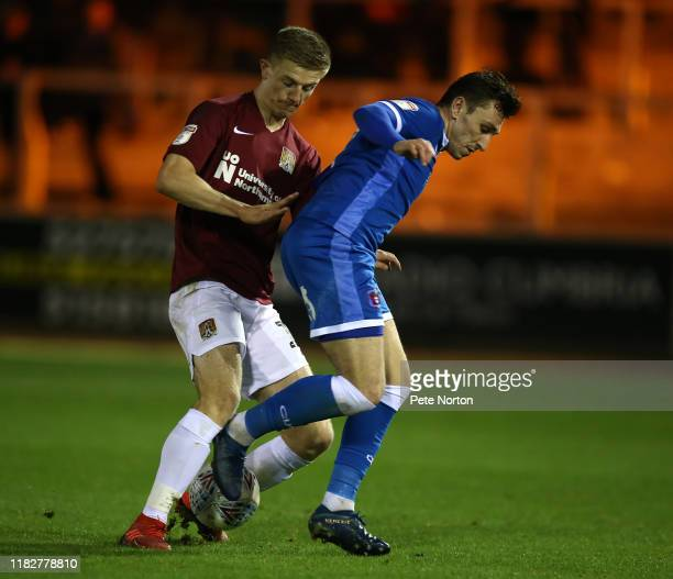 Nathan Thomas of Carlisle United attempts to control the ball under pressure from Scott Wharton of Northampton Town during the Sky Bet League Two...