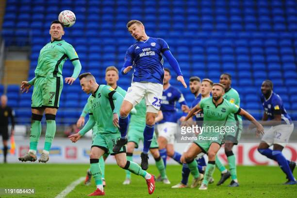 Nathan Thomas of Carlisle United under pressure from Danny Ward of Cardiff City during the FA Cup third round match between Cardiff City and Carlisle...