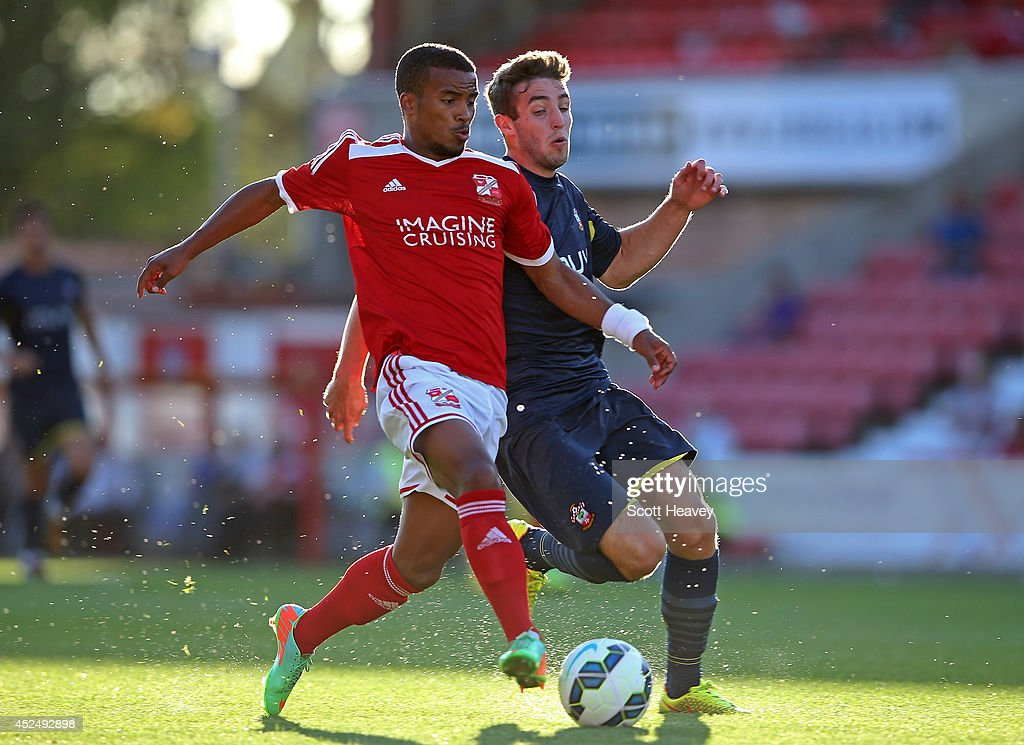 Nathan Thompson of Swindon (L) in action with Sam McQueen of Southampton during the Pre Season Friendly between Swindon Town and Southampton on July 21, 2014 in Swindon, England.