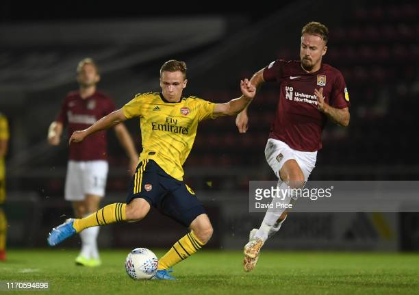 Nathan Tormey of Arsenal passes under pressure from Chris Lines of Northampton during the Leasingcom match between Northampton Town and Arsenal U21...