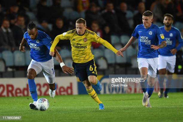 Nathan Tormey of Arsenal takes on Rhys Bennett of Peterborough during the Leasingcom Cup match between Peterborough United and Arsenal U21 at Weston...