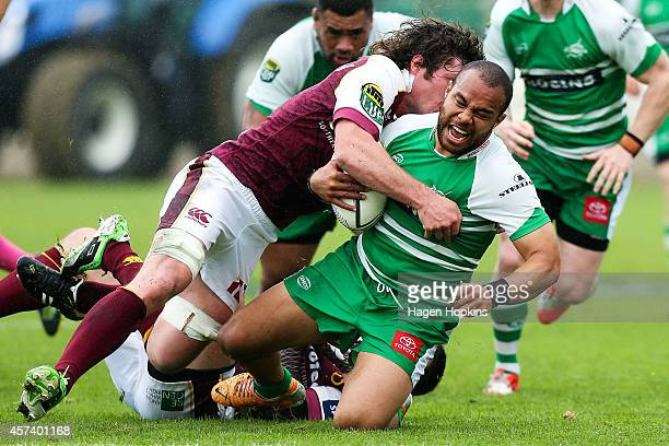 Nathan Tudreu of Manawatu is tackled by Tim Boys of Southland during the ITM Cup Championship Semi Final match between Manawatu and Southland at FMG...