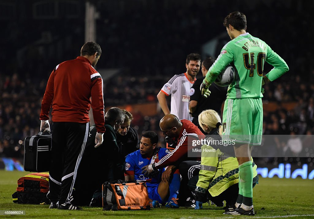 Nathan Tyson of Doncaster is treated after falling awkwardly during the Capital One Cup Third Round match between Fulham and Doncaster Rovers at Craven Cottage on September 23, 2014 in London, England.