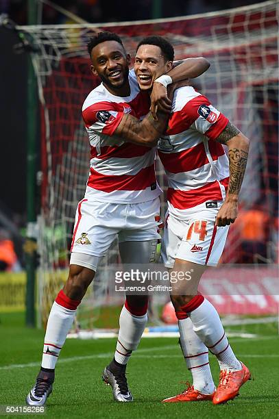 Nathan Tyson of Doncaster Rovers celebrates scoring his team's first goal with his team mate Cedric Evina during the Emirates FA Cup Third Round...