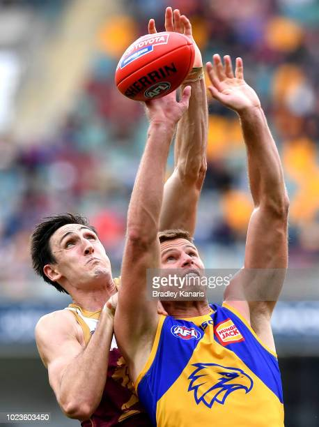 Nathan Vardy of the Eagles and Oscar McInerney of the Lions challenge for the ball during the round 23 AFL match between the Brisbane Lions and the...