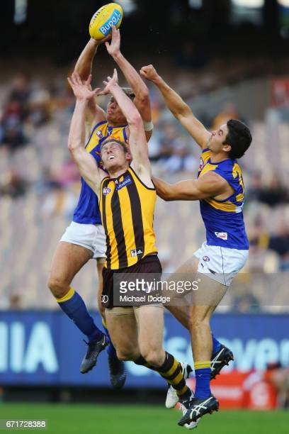 Nathan Vardy of the Eagles and Tom Barrass of the Eagles compete for the ball over Ben McEvoy of the Hawks during the round five AFL match between...