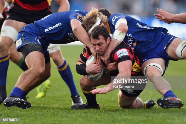 Nathan Vella of Canterbury is tackled during the round two Mitre 10 Cup match between Canterbury and Otago on August 27 2017 in Christchurch New...