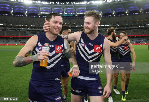 Nathan Wilson and Cam McCarthy of the Dockers walk from the field after winning the round 18 AFL match between the Fremantle Dockers and the Sydney...