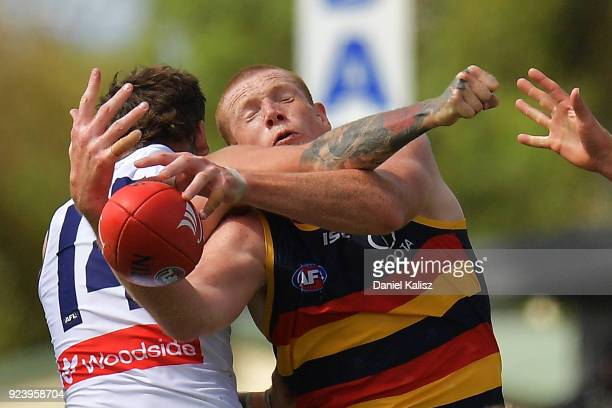 Nathan Wilson of the Dockers competes for the ball with Sam Jacobs of the Crows during the JLT Community Series AFL match between the Adelaide Crows...