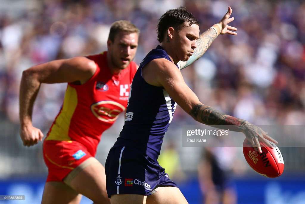 Nathan Wilson of the Dockers passes the ball during the round three AFL match between the Gold Coast Suns and the Fremantle Dockers at Optus Stadium on April 7, 2018 in Perth, Australia.