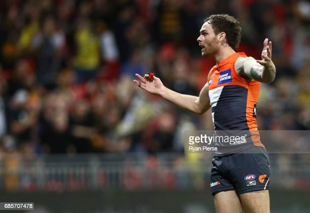 Nathan Wilson of the Giants remonstrates with the goal umpire after the shot on goal from Shai Bolton of the Tigers was touched during the round nine...