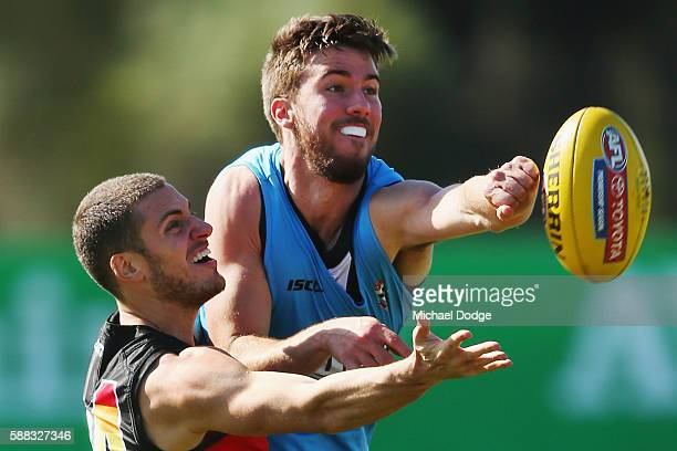 Nathan Wright of the Saints compete for the ball against Daniel McKenzie during a St Kilda Saints AFL training session at Linen House Oval on August...