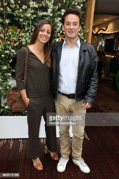 Nathanael de Rincquesen and Caroline Malet attend the 2018 French Open Day Three at Roland Garros on May 29 2018 in Paris France
