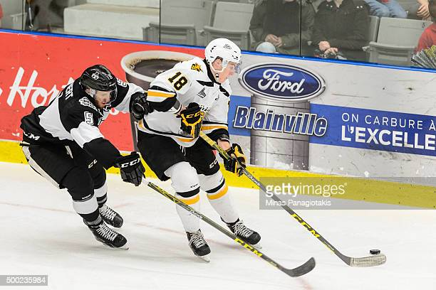 Nathanael Halbert of the BlainvilleBoisbriand Armada challenges PierreLuc Dubois of the Cape Breton Screaming Eagles during the QMJHL game at the...
