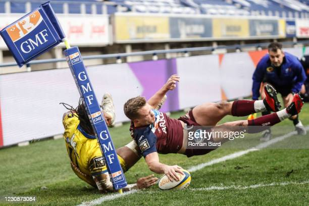 Nathanael HULLEU of Bordeaux score his try and Alivereti RAKA of Clermont during the Top 14 match between Clermont and Union Bordeaux Begles at Parc...