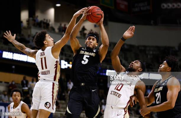 Nathanael Jack of the Florida State Seminoles and Malik Osborne of the Florida State Seminoles defend D'Shawn Schwartz of the Colorado Buffaloes...