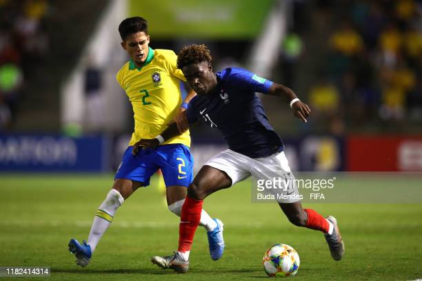 Nathanael Mbuku of France battles with Yan Couto of Brazil during the FIFA U17 World Cup Brazil 2019 semifinal match between France and Brazil at...