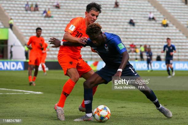 Nathanael Mbuku of France is tackled by Mohamed Taabouni of Netherlands during the 3rd Place Playoff match between the Netherlands and France at the...