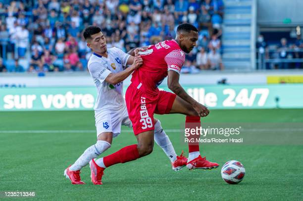 Nathanael Saintini of FC Sion battles for the ball with Toichi Suzuki of FC Lausanne-Sport during the Super League match between FC Lausanne-Sport...
