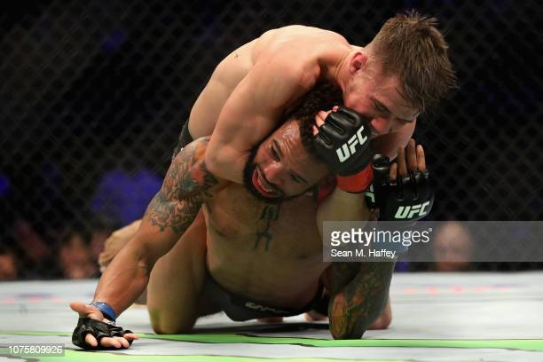 Nathanial Wood of Great Britain defeats Andre Ewell by submission during a Bantamweight bout during the UFC 232 event inside The Forum on December...