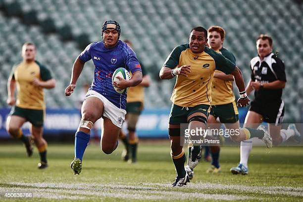 Nathaniel Apa of Samoa makes a break during the 2014 Junior World Championship 5th Place Semi Final match between Australia and Samoa at North...